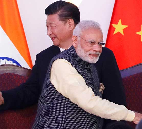 In this Oct. 16, 2016, file photo, Indian Prime Minister Narendra Modi, front and Chinese President Xi Jinping shake hands with leaders at the BRICS summit in Goa.